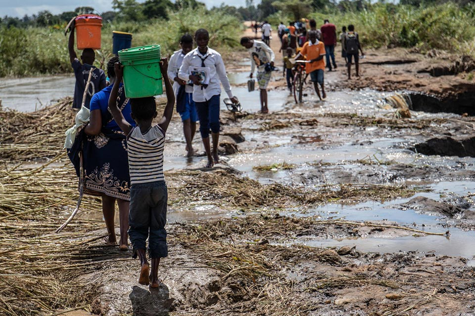 Child carrying water after Cyclone Kenneth hit Mozambique