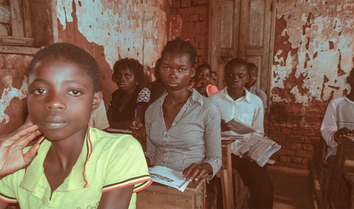 People in school after population displacement in the DRC