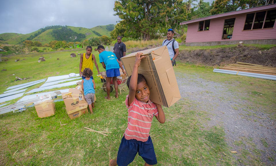 Everyone helping reconstruction after cyclone in Fiji
