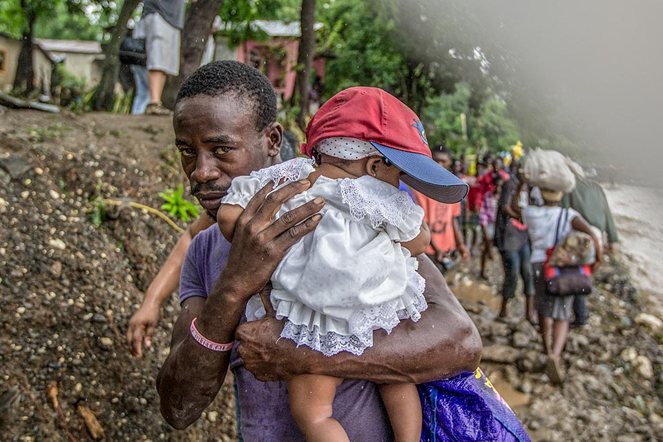 father and daughter from Haiti after Hurricane Matthew