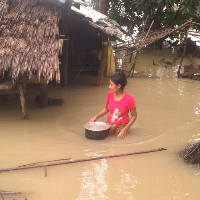 Woman in flooded area in Myanmar