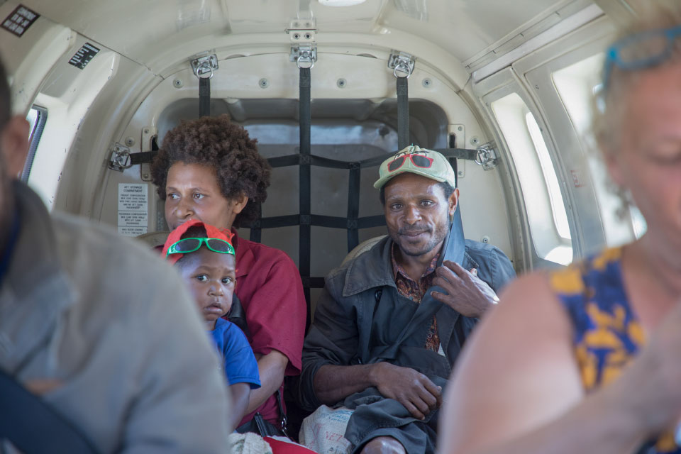 Papua New Guinea family in airplane
